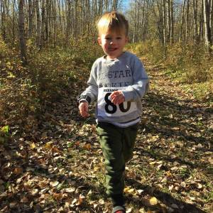 3 year old Canyon Sherk smiled his way to a 27th place finish in the JEB 1.3 km in the 2016 Bezanson Bog